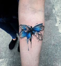 Blue watercolor dragonfly on forearm by Aleksandra Kozubska