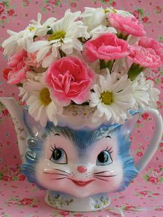 Vintage  Kitty Teapot with flowers..I often do this with whimsical odd pieces..they sell!