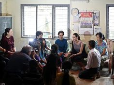 Angelina Jolie Pitt (centre right) with Myanmar's opposition leader and democracy campaign Aung San Suu Kyi (centre left) on a visit to a women's factory in Burma's largest city of Yangon