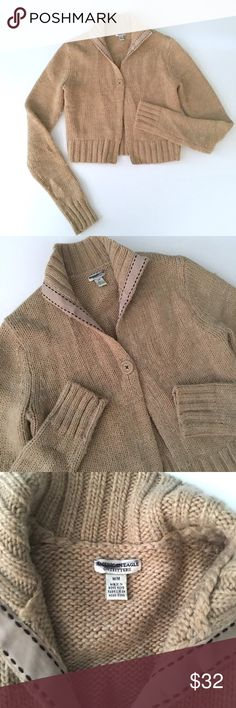"""AEO Crop Camel Wool Cardigan American Eagle Outfitters Crop Camel Brown Sweater Cardigan // sz M // 50% wool, 50% acrylic //Single button front closure // Full length sleeves // Color is most like first and last pictures // decorative ribbon lining on inner collar // minimal to no pilling // I have used a sweater shaver on it // non-smoking home // 17"""" across armpits and stretches to 22"""" // 30"""" sleeves // 18"""" length //not my size. Can't model. // 10.29.32 14.4o-.52 / Bundle Discounts…"""