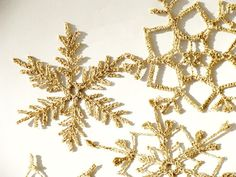 12 Gold sparkling Crochet snowflakes christmas by zolayka on Etsy, $38.00 #christmas #snowflakes #gold