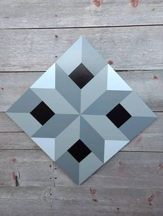 This unique one of a kind barn quilt would look great on your fence, barn, garage, outside buildings or house inside or out. It is painted in 3 shades of grey with black in the center. It is a very 3-D and optical illusion pattern. This unique pattern is hand drawn on a primed 2x2