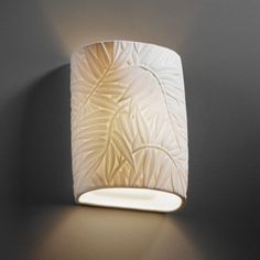 Leaf embellished wall sconce available at Statements In Tile/Lighting/Kitchens/Flooring.