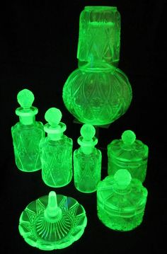 8 pc art deco vaseline glass uranium glass antique dressing table set, vanity set, extensive set!! by ElflingAntiques on Etsy https://www.etsy.com/listing/293977069/8-pc-art-deco-vaseline-glass-uranium