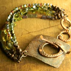 Gorgeous combination of green Czech glass beads and copper in a rustic bracelet design by Gloria Ewing.