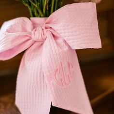 Monogrammed Bouquet Wrap   Trade in a traditional silk ribbon bouquet wrap for a pink seersucker bow—monogrammed, of course.   SouthernLiving.com
