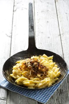 Traditional Cheese spaetzle topped with caramelized onions: Käse Spätzle