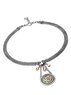 A classic layered pendant necklace in Sterling Silver and 18ct Gold adorned with bejeweld charms, decorated with striking calligraphy spelling Hearts with eyes of Vision