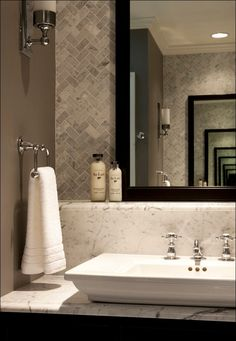 marble splashback that doubles as countertop. Mirror rests on it rather than wall-hung. Colour of walls