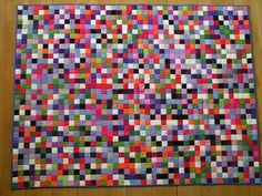 Postage stamp quilt - each square began at 1 1/2 inches, resulting in a 1-inch square showing on the quilt top.