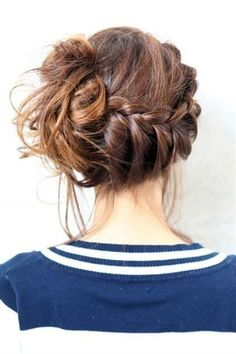 French braid going into a messy bun