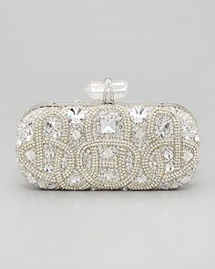 Between the crystal and glittering pavé details, Marchesas embroidered stone box clutch ($3,295) is a bride's dream. #bridal