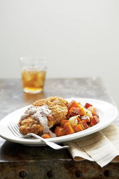 A classically Southern cubed steak with fresh marjoram dotting the flour-cracker coating mixture.    Recipe:Country-Fried Steak with Uncle Ellis' Cornmeal Gravy