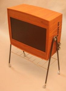 This is a 60s TV from DUX. The old TV parts have been removed and replaced with  a new flat TV