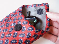 What a great project!  Turn an old man's necktie into a cute case for sunglasses,  scissors, or many other small objects.  So many homeless ties, so many possibilities!
