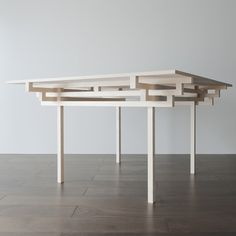 Japanese architect Hiroyuki Tanaka designed the structure of this table based on the roof and pillar systems of ancient temples.