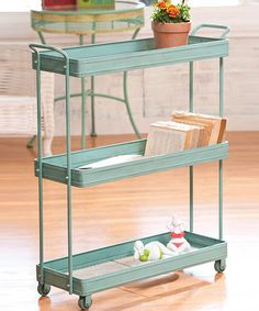 Charming and chic, this retro cart is perfectly practical. Adorn it with cookbooks and potted plants in the kitchen, or stack it with trinkets and treasures in the living room. Casters make it easy to move from room to room!