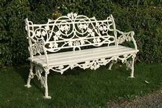 attractive french garden bench with a cast iron back ...