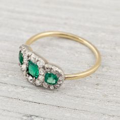 Three Stone Diamond and Emerald Engagement Ring Circa 1900