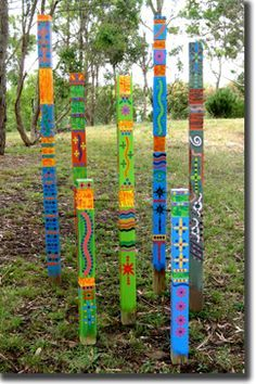 Garden totems. I would bet these would be easy to make...some 2 x 4's, paint, stamps, etc. and stick in the ground.
