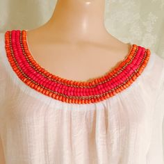 White blouse with Colorful collar. White blouse with Colorful collar with 3 colors. Orange, pink and gold beads. 40% cotton 60% polyester. 3/4 sleeves. Fabric has a beautiful pattern. Tops Blouses