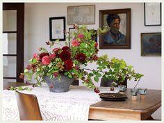 love the old school dramatic flowers, restrained gallery wall, vintage linens, French doors