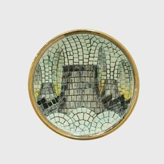 Yuri Ancarani Souvenir 2010 collezione MCZ  grès bianco inciso e smaltato con oro / glazed and carved white stoneware with gold glaze Ø cm 20,7  Ceramista / ceramist: Aida Bertozzi