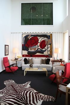 "The Kips Bay Decorator Show House this year isn't all green.  Bunny Williams, Brian J. McCarthy, and David Kleinberg, all former employees of Albert Hadley, collaborated on a fabulous Venetian plastered white living room punctuated with pops of red.  There are also a few mementos from Mr. Hadley including his ""Don't Forget"" memo pads and ever present Camel Lights and famous hooked zebra rug"