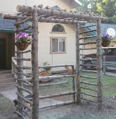 Rustic trellis created out of natural logs.