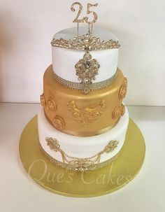 3 tier gold and white cake with jewels