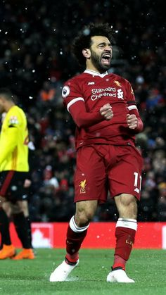 Mohamed Salah of Liverpool celebrates scoring his side's fourth goal during the Premier League match between Liverpool and Watford at Anfield on March 2018 in Liverpool, England. Liverpool Fc Wallpaper, Liverpool Wallpapers, Liverpool Players, Liverpool Football Club, Mohamed Salah Liverpool, Muhammed Salah, Messi And Ronaldo, Mo Salah, Premier League Matches