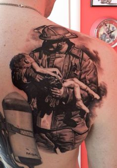 Firefighter and child tattoo (shoulder-back) | Shared by LION *That's a scene from the Oklahoma City bombing in 1995