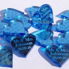 Pale Blue Mirror Wedding Heart Decorations, perfect table favour confetti for decorating the venue or tables.  They also make great keepsakes for the guests to take away or to create memory scrapbooks after the big day.  Personalise with ANY TEXT of your choice, Mr & Mrs, Mr & Mr or Mrs & Mrs for same sex wedding and any surname and wedding date of your choice.