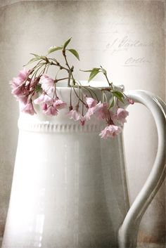White carafe with pink flowers.