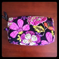 Vera Bradley Small Cosmetic in Pirouette Pink  EUC Vera Bradley small cosmetic bag in Pirouette Pink   Beautiful pink floral pattern with orange, green and purple on black background. No stains. No signs of wear. Rare pattern. Perfect size for tossing in your purse! Vera Bradley Bags Cosmetic Bags & Cases