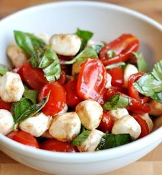 Light, flavorful and so easy to make, this cherry tomato caprese salad is a favorite summer side dish. The fresh basil and mozzarella take it way over the top! #basil #tomato #cherrytomato #capresesalad #mozzarella #summersalad #sidedish #garden #melskitchencafe