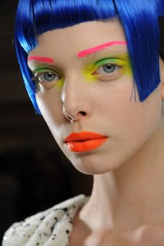 Neon brows, eyes and lips a bit clownish but fun.