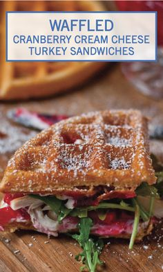 Celebrate Thanksgiving in a new, delicious way with these Waffled Cranberry Cream Cheese Turkey Sandwiches. Start with a fluffy, golden waffle. Then, layer on rich cream cheese, savory turkey, sweet cranberry sauce, and fresh arugula. Top with a sprinkling of powdered sugar, and enjoy!
