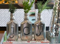 "Krylon Looking Glass Mirror Like spray paint applied to Jack Daniels bottles to form a ""joy"" holiday vignette"