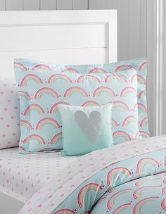 Heart and rainbow bedding — that would inspire us to make our beds every morning! The percale cotton used in this set makes for long-lasting sheets.