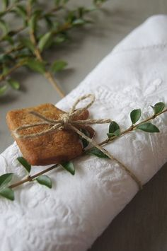 Gingerbread cookie wrapped around the napkin with twine.