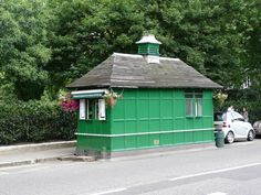 Cabmen's Shelter. London. One of thirteen left. They were provided by the Cabmen's Shelter Fund, a charity set up under the Earl of Shaftesbury and others in 1874 with the object of providing places where cabmen could obtain 'good and wholesome refreshments at moderate prices'. By this provision it hoped to keep the cabbies out of the pubs! Painted in a variant of Brunswick Green.