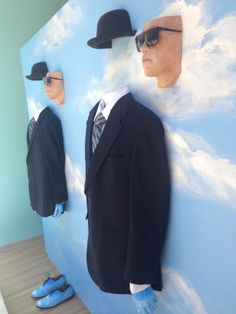 """Inspired by the MOMA exhibition, we've created a new window display that we think Magritte would approve of. It features a sky backdrop found in many of Magritte's paintings and men in the Magritte style – complete with suit, period dress shoes and bowler hat. We chose Arnold Schwarzenegger's visage as the face of the men"", pinned by Ton van der Veer"
