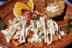 Chilaquiles with red sauce and grilled chicken. Start your day with these at Si Señor Beach Restaurant in Puerto Vallarta, Mexico.