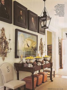 Stunning entry, the stacked paintings, the lamp, the table.  I like the idea of having portraits, especially of family, lined up to greet all who enter.  ~ the home of P. Allen Smith
