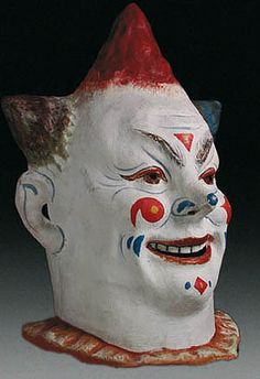 Clown party mask    Chicago, Illinois    17 inches, painted papier mache…