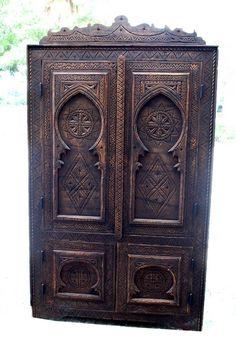 A unique hand carved Moroccan corner cabinet, made of cedar.
