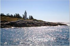 Grampy and Grammy spent their honeymoon and 6 years here - (6 miles to Round Pont, 6 miles to Friendship and 6 miles to Port Clyde - rowing!!)  Franklin Island Light - Muscongus Bay - Maine