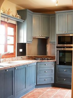 Milk painted kitchen cabinets in wedgewood blue