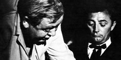 """Director Charles Laughton and star Robert Mitchum on the set of """"Night of the Hunter"""" (1955)."""